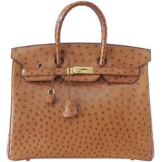 HERMES BIRKIN 35 COGNAC Ostrich gold hardware with plastic ❤ liked on Polyvore featuring bags