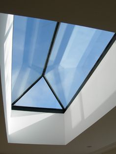 This blue tinted glass rooflight will make any room look light and airy.....beautiful.