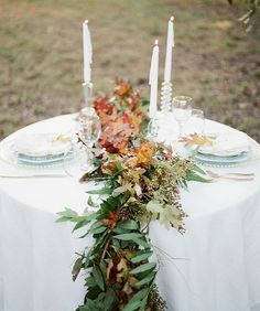 Simple garland with touches of red for the sweetheart table.