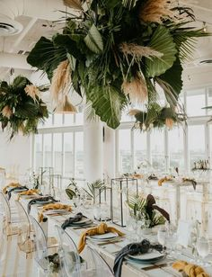 Tropical wedding inspiration with hanging greenery and pampas grass installations, tropical wedding flowers, ghost chairs, rustic white tables, minimalist wedding tablescapes and decor Tropical Wedding Centerpieces, Tropical Wedding Decor, Floral Wedding, Decor Wedding, Tropical Weddings, Wedding Ideas, Tropical Decor, Wedding Night, Modern Wedding Decorations