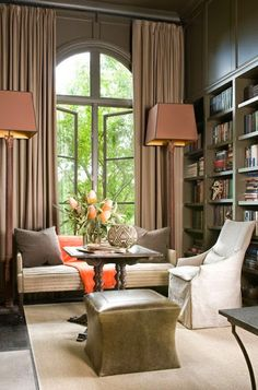 beautiful brown and cream den with orange hermes blanket gray painted built in bookcases
