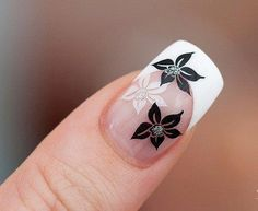 I actually like these little black flowers! Would be pretty to do them in red for Christmas!!