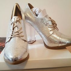 ASOS SILVER POWER TRIP HIGH HEELS NWB gorgeous silver metallic textured heels with front lace. Beautiful and new fits sz 8 or 8.5 ASOS Shoes Platforms
