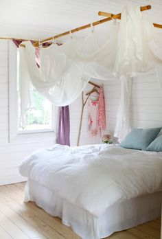 Love the canopy!  Try to do this in spare bedroom.