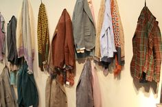 Salvatore piccolo - hanging clothing in fall colors