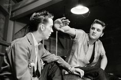 May 27, 1956. Dayton, Ohio. A 21-year-old Elvis Presley with his cousin Gene Smith backstage at the University of Dayton field house, where they sang for a zillion swooning coeds. 35mm negative by Phillip Harrington.
