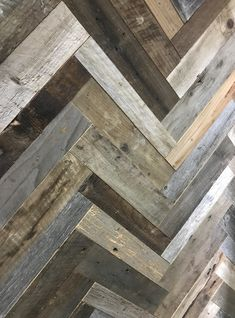 Finium Noble - Brace (Reclaimed Barnwood) close up of panels installed in the studio #Finium #hardwoodpanels #wallpanels #hardwood #woodsurfaces #interiorsurfaces #rusticdecor #textures #interiordesign #interiorstyling #timberwall #barnwood #woodwallpanels