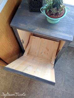 The inside of a wood tilt for a trash can                                                                                                                                                                                 More