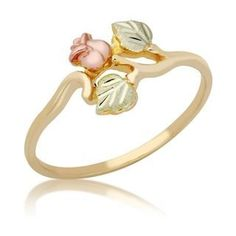 This charming black hills gold rose ring is crafted from yellow gold. The twisting, gold band gives this ring an organic look, the pink rose seeming to grow right out of the gold. The rosebud and leaves are crafted from black hills gold. Black Hills Gold Jewelry, Rose Gold Jewelry, Fine Jewelry, Jewelry Rings, Jewelry Shop, Opal Jewelry, Indian Jewelry, Jewelry Ideas, Beaded Jewelry