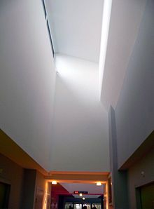 A light shelf is an architectural element that allows daylight to penetrate deep into a building. This horizontal light-reflecting overhang is placed above eye-level and has a high-reflectance upper surface. This surface is then used to reflect daylight onto the ceiling and deeper into a space.