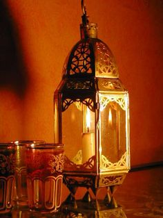Moroccan brass table top lantern. http://www.maroque.co.uk/showitem.aspx?id=ENT00105&s=20-10-017
