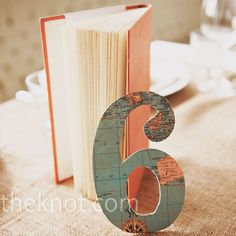 Nice idea for coordinating world map themed table numbers.