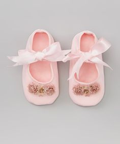 Worthy of cherishing now and as a future keepsake, these itty-bitty mary janes radiate the sweetness of childhood style. Delicate blossoms give the ribbon-tied pair plenty of charm and enchantment. Ribbon closurePolyesterImported