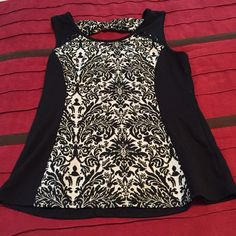 Dressy tank top Black and cream colored dressy tank top with bow in the back. Maurices Tops Tank Tops