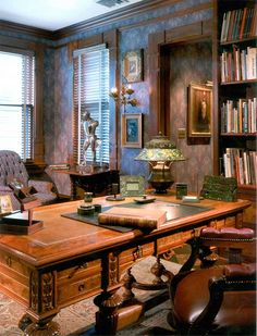"The study features a Herter Brothers burled walnut desk, lit by a Tiffany Studios lamp. In front of the window is the silver-gilt bronze sculpture ""Il Grande Trovatore"" by Giorgio de Chirico."