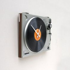 This blows my DIY record clock out of the water....