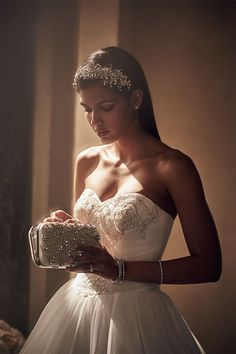 Complement your embellished dress with a timeless crystal headband. Make an appointment at davidsbridal.com, and a stylist will help you put together your whole look.