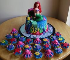 Made for a little girl's 6th birthday; cupcakes were frosted with buttercream and decorated with fondant sea creatures; cake was 3-laye...