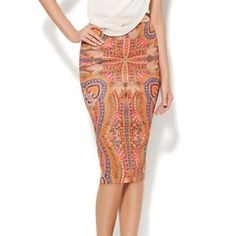 Medallion Print Scuba Skirt 2,4,6,&8 95% Polyester 5% Spandex Invisible back zipper Center back length 27 inches. Sizes 2,4,6,&8 Skirts Pencil