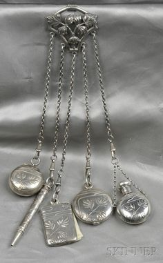 Art Nouveau .800 Silver Chatelaine, with perfume, notepad, pencil, photograph case, and compact, all with foliate motifs, total lg. 8 1/4 in., Continental hallmarks.