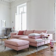 Pink blush sofa in white millwork living room