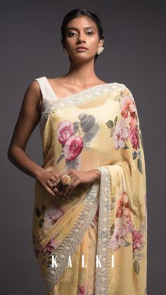 Blonde yellow saree in georgette with floral print. Beautified with cut dana, pearls and sequins embroidered floral pattern on the scalloped border. Paired with a matching unstitched blouse in georgette. Yellow Saree, Stylish Sarees, Elegant Saree, Saree Look, Fancy Sarees, Georgette Sarees, Indian Designer Wear, Beautiful Indian Actress, Indian Wear
