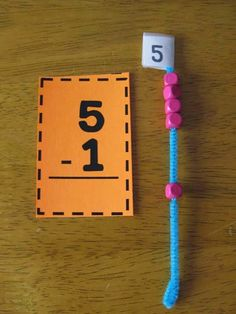 Using Beaded Number Rods to help kids visualize addition/subtraction.