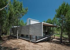 Architect Luciano Kruk built an exposed concrete house set amidst a pine forest on Argentina's Costa Esmeralda. Concrete Architecture, Contemporary Architecture, Architecture Design, Beton Design, Concrete Design, Beachfront House, Concrete Houses, Exposed Concrete, Architecture Magazines