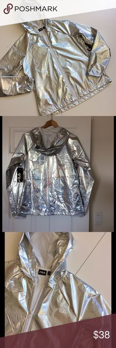 """Super Light Cool Silver FILA Jacket Hood NWT This athleisure jacket is amazingly lightweight and so cool! Front pockets, adjustable bottom opening and adjustable hood. Measurements: chest 44""""; waist 40""""; bottom up to 44""""; length from shoulder 24"""" Fabric: 100% polyester. Machine wash  Condition: NWT Bundle discount  ⭐️5 star rated Suggested User Smoke free home I don't trade  Thank you for shopping with me. Please feel free to ask questions Fila Jackets & Coats"""