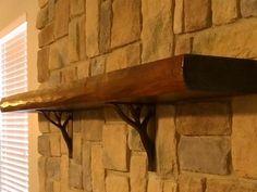 corbels for granite countertops   Willow corbels mounted under wood mantel