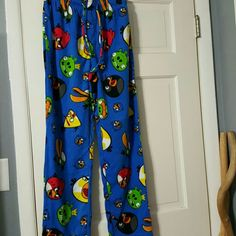 """Angry Birds fleece pajama pants small A pair of cute Angry Birds fleece pajama pants in size small.  **No tag but Never worn!  Bright and colorful blue with different birds on them.  Has drawstring and elastic waist with buttons on crotch. ***Waist is 13"""" inches (26"""" inches around).   ***Length from top to bottom is 40"""" inches long. No trades. Angry Birds Intimates & Sleepwear Pajamas"""