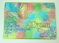 Altered playing card using Elizabeth Craft Designs' A Way with Words die, Sizzix Butterfly Duo faded die set, Ranger Distress Products and crafty love.  :)  A fun mixed media project!