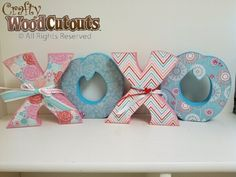 XOXO Wood Craft Idea. This craft costs $10.99 and is about 26″ wide and 7″ tall.
