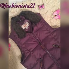 """FLASH SALE UGG Puffer Vest large High quality Authentic Ugg Puffer Vest. Outer shell 100% nylon 2 diagonal zip pockets with leather pulls outside and one interior pocket. Lining is 100% poly. 50% DOWN 50% Cluster real. Detachable fur collar. Light eggplant /mauve in color. Look at pics. 18"""" across under arm to under arm flat lay. Approx 23"""" in length from shoulder to front bottom. 6"""" wide front pockets. Mint condition UGG Jackets & Coats Vests"""