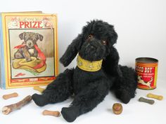 Melody is a cute 1950s black poodle toy dog with a musical movement inside her that plays strangely enough Three blind mice !!  She is a English toy dog possibly by Deans/ Farnell or Pedigree  www.onceuponatimebears.co.uk
