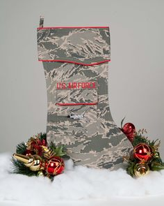 """Beautifully tailored stocking crafted in the the Air Force """"digital camouflage"""" uniform fabric. It's trimmed in scarlet piping with a image embroidered on the stockings pocket and embroidered U. Christmas Stocking Pattern, Christmas Stocking Holders, Christmas Stockings, Christmas Care Package, Military Crafts, F 16 Falcon, Air Force Mom, Tiger Stripes, Holiday Traditions"""