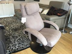 Katia swivel and reclining armchair in microfibre material. Comfortable and beautiful armchair. Available in fabric and leather, and different finish for the base.