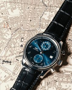 The classically balanced dial of this IWC-manufactured chronograph leans heavily on the design of the first, iconic Portugieser models of the Iwc Watches, Wrist Watches, Blue Plates, Luxury Watches For Men, Chronograph, Omega Watch, Classic, Outfit Goals, Men's Accessories