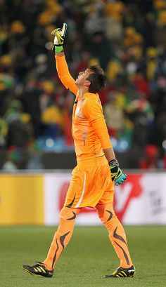 PRETORIA, SOUTH AFRICA - JUNE 16: Goalkeeper Fernando Muslera of Uruguay celebrates their victory at the end of the 2010 FIFA World Cup South Africa Group A match between South Africa and Uruguay at Loftus Versfeld Stadium on June 16, 2010 in Tshwane Awesome. Love it.