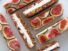 raw vanilla coconut fig slice; a walnut, almond, coconut, flax, dried fig, date, cinnamon base filled with a cashew cream made with coconut milk, coconut, maple, and vanilla bean; decorated with fig slices