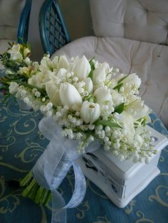 Most romantic and auspicious ever: lily of the valley and white tulips. Nothing more lovely!