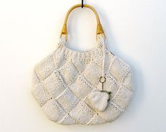 white tote bag  knitted in cotton with rattan handles by branda, $75.00