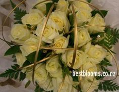 loops of grass (painted gold) in the bouquet