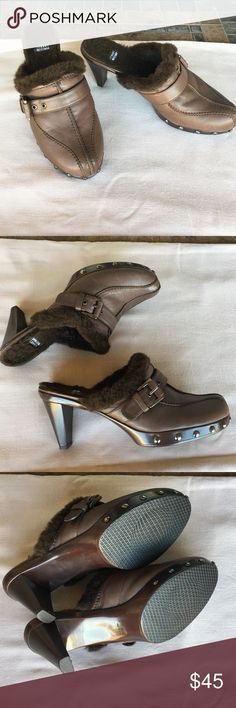 "STUART WEITZMAN MADE IN SPAIN Size9 In excellent condition,like new,genuine leather ,brown studded clogs by Stuart Weitzman ,Fits good to size 9 .Heel 3"" Faux fur inside. Stuart Weitzman Shoes Mules & Clogs"