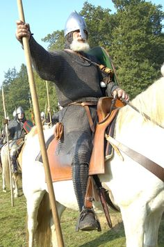 A grey bearded Norman warrior sitting astride his steed.