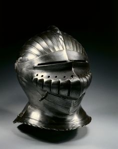 """Close Helmet in Maximilian Style, c. 1510-1530 Germany, Nuremberg(?), 16th century steel, brass rivets, Overall - h:29.20 w:34.90 d:23.50 cm (h:11 7/16 w:13 11/16 d:9 1/4 inches) Wt: 2.82 kg.  Distinguished by its regularly fluted surfaces, armor in this style was popularized in South Germany during the early 1500s. The style is usually called """"Maximilian,"""" as it was introduced during the reign of Emperor Maximilian I (1493-1519) Cleveland Museum of Art"""