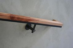 Modern handrail with black metal bracket and wooden top 522industries | 522…