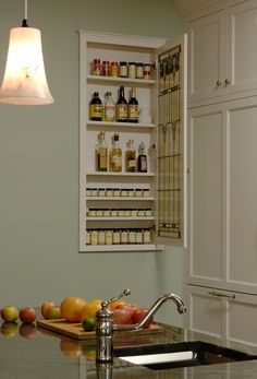 Making use of space between studs for a spice and condiment cabinet.
