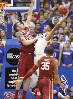 Kansas guard Kelly Oubre Jr. (12) pulls back for an attempted dunk against Oklahoma forward Ryan Spangler (00) during the second half on Monday, Jan. 19, 2015 at Allen Fieldhouse.