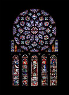 The north transept rose of Chartres Cathedral. The window includes the arms of France and Castile.
